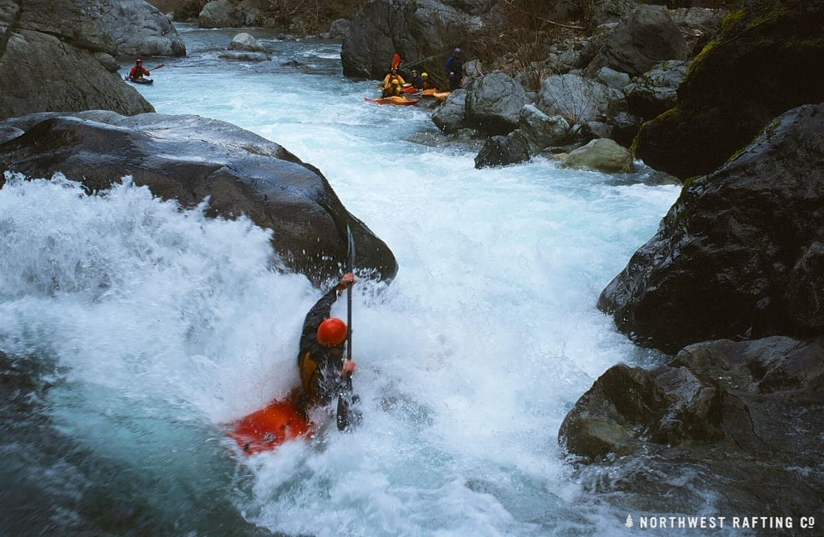 Kayaker going right of the rock in the left channel at Island Rapid